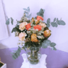 Orvieto Bouquet nei toni arancio di Rose, Nutan e Dianthus